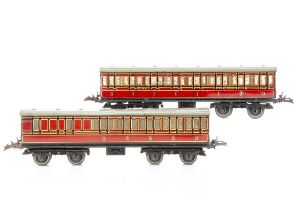 Two Hornby 0 Gauge No 2 Passenger Coaches, both in lithographed LMS crimson, as brake/3rd no 22705