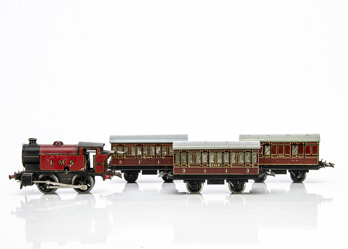 A Hornby 0 Gauge clockwork M3 0-4-0T Locomotive and 3 Coaches, all in lithographed LMS crimson,