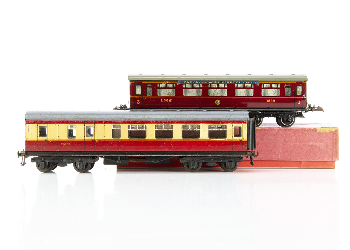 A Hornby 0 Gauge No 2 Corridor Coach and Bassett-Lowke BR coach, in lithographed LMS crimson as