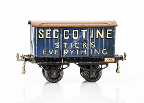 An early Hornby 0 Gauge 'Seccotine' Private Owner Van, on black 'OAG' base with large drop-link