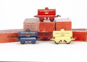 Boxed Pre-war Hornby 0 Gauge Tank Wagons, comprising cream 'Motor BP Spirit' (2), red 'Shell' (2),