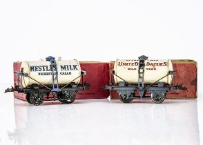 Hornby 0 Gauge Milk 'Super-Tankers', both on T3 bases with 'gagged' truss rods, United Dairies on