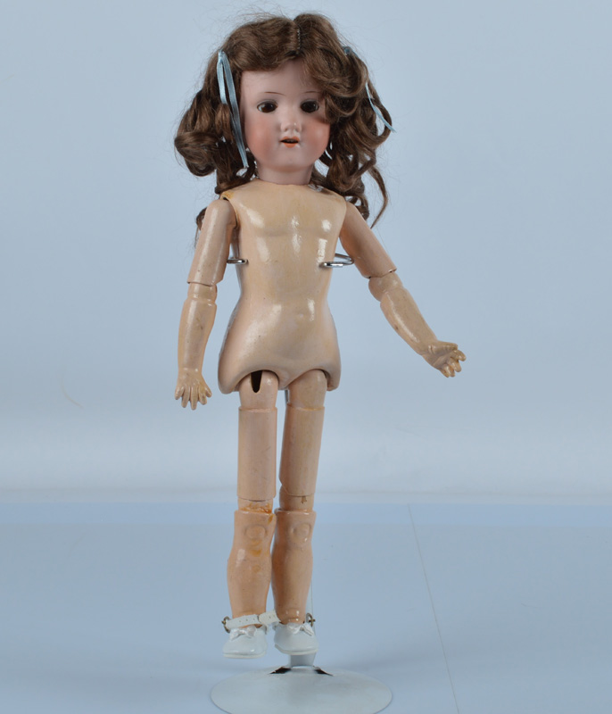 A small Armand Marseille 390 child doll, with brown sleeping eyes, brown mohair wig and jointed