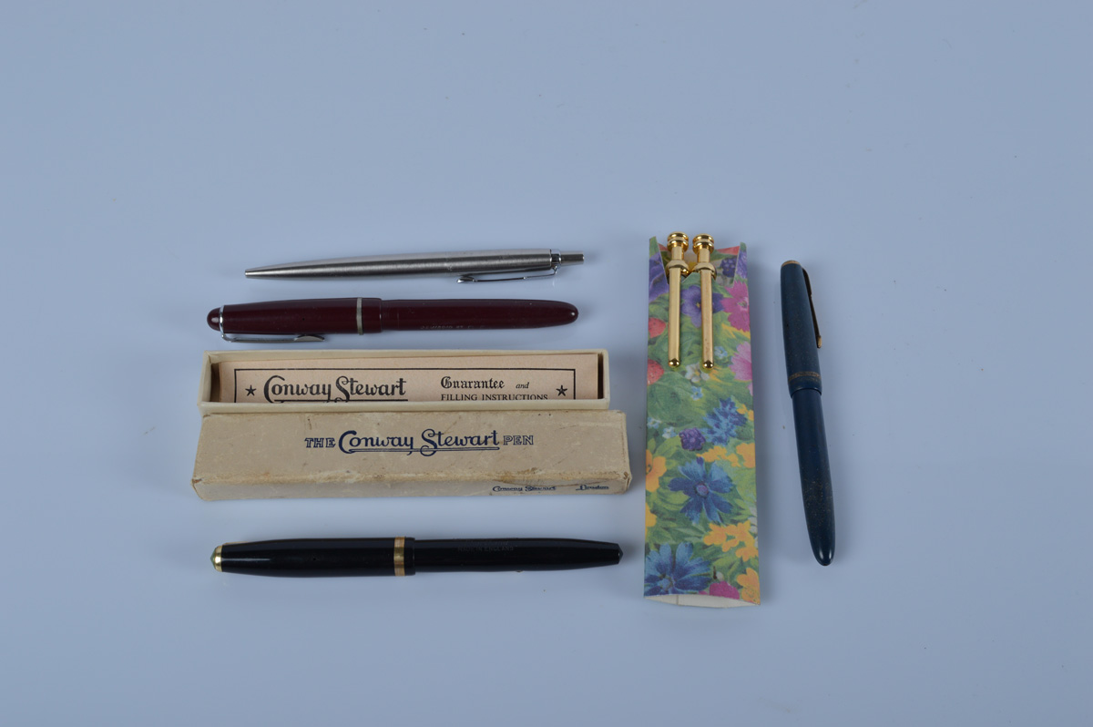 A Conway Stewart boxed fountain pen, with 14K nib, together with a Parker example with 14K nib,