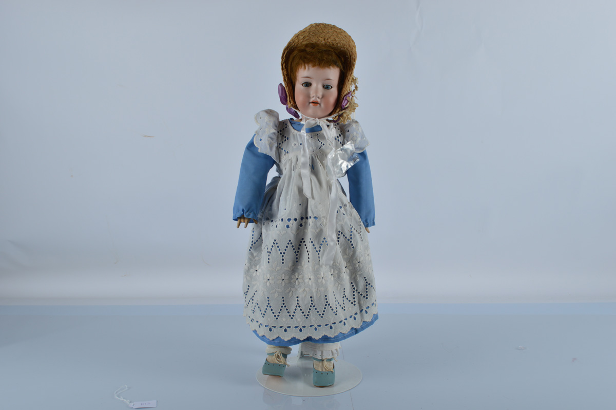 An Armand Marseille 390 child doll, with blue sleeping eyes, remains of brown mohair wig, jointed