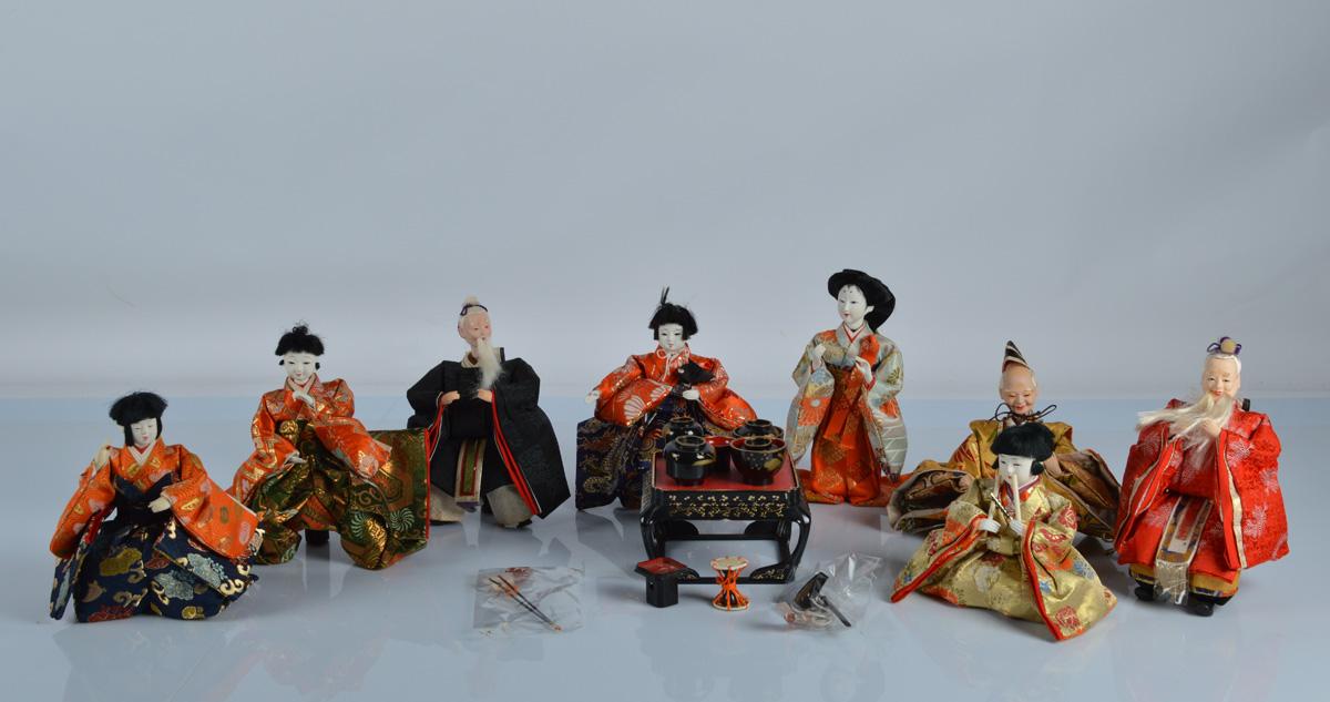 Eight Japanese gofun festival dolls, including three elderly men and a tea ceremony of recent