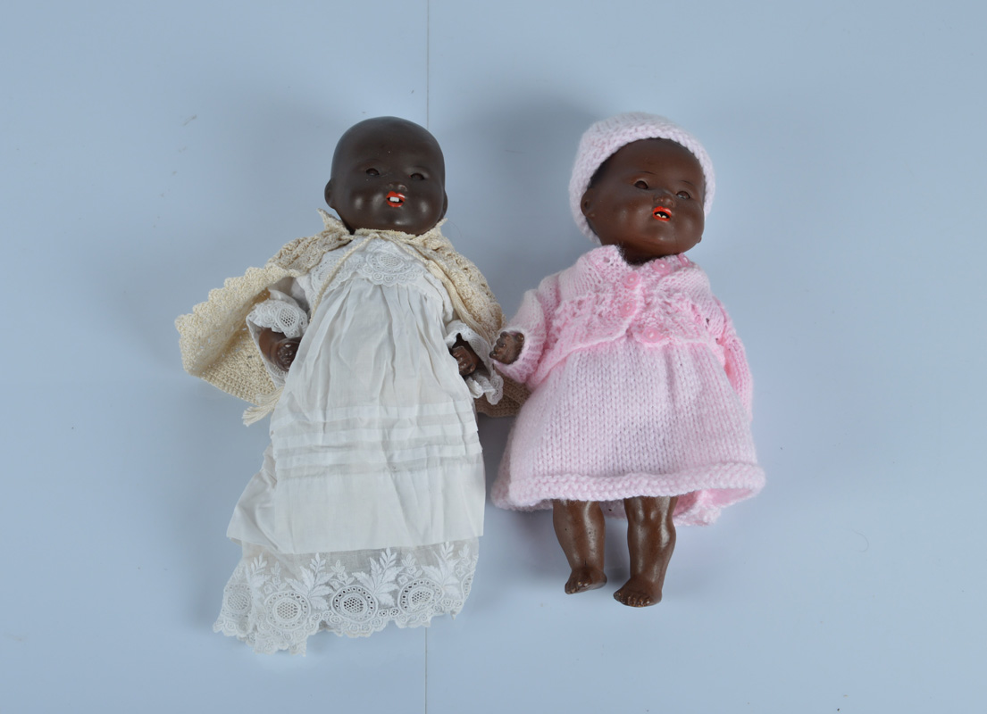 Two small Armand Marseille painted bisque black 351 babies, with sleeping eyes, bent limbed