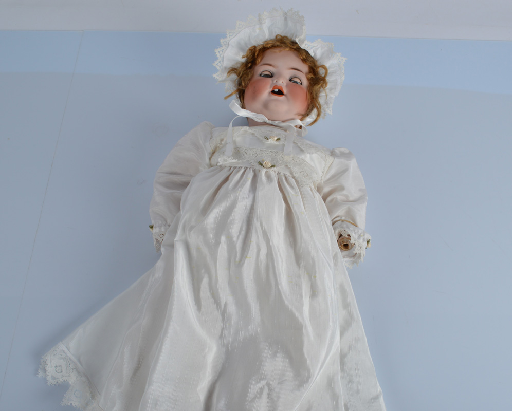A large Cuno and Otto dressed character baby, with blue sleeping eyes, curly blonde wig, bent limbed