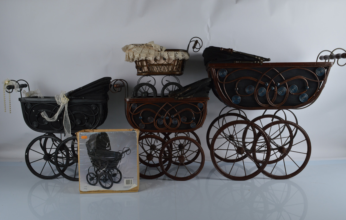 Five contemporary ratan Edwardian style doll prams, in brown, black with wirework scroll supports