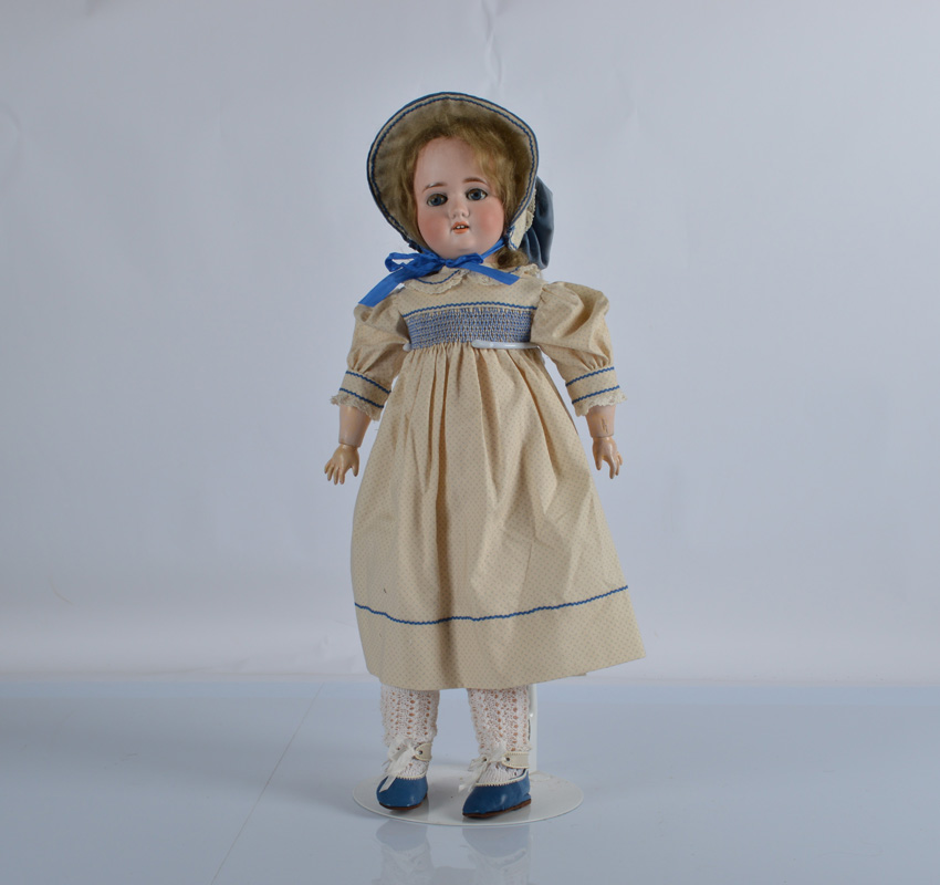 A German child doll marked AH, probably Adolf Hulss with blue lashed sleeping eyes, blonde mohair