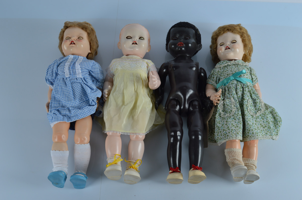 Four Pedigree walking dolls, including a black child doll