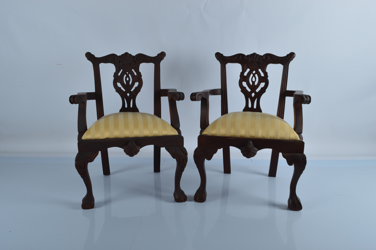 A pair of Chippendale style reproduction child's armchairs, with shaped leaf back rest, pierced
