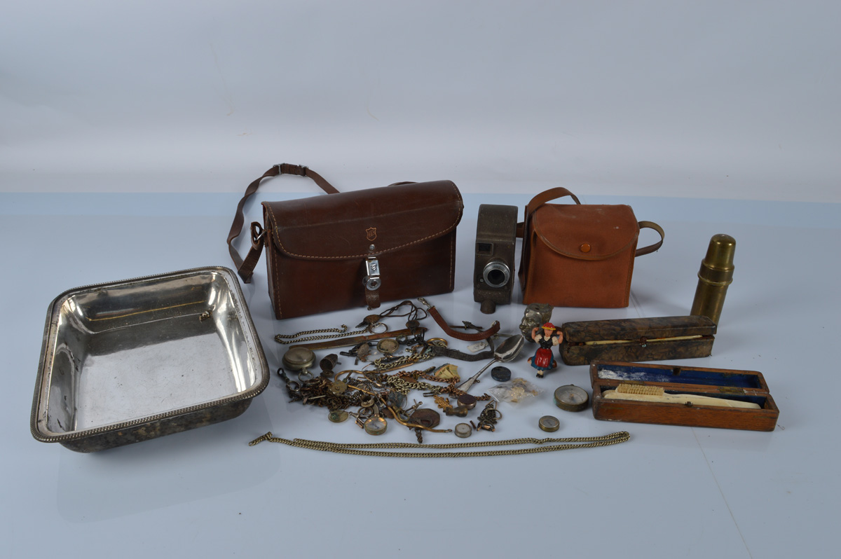 A mixed lot of collectables, including a Bell & Howell 134 Movie Camera, fob compasses, silver