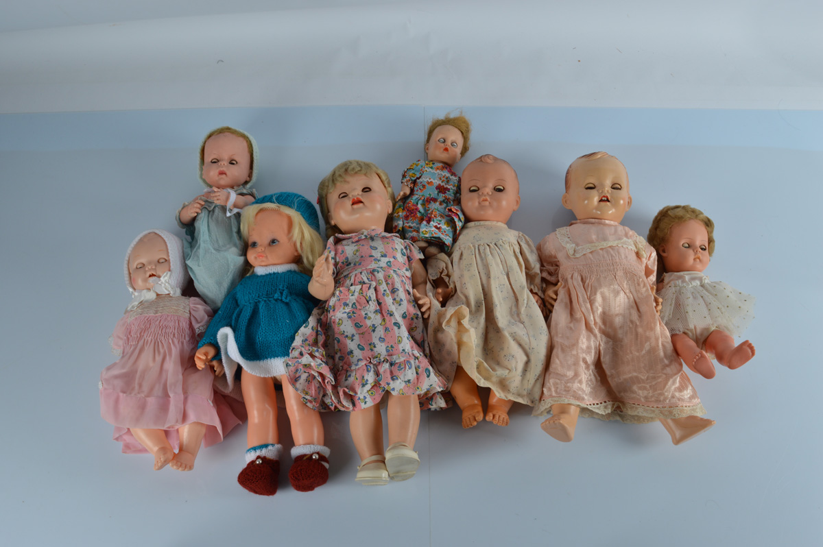 A collection of plastic and vinyl baby and child dolls, including a BND child doll with weighted