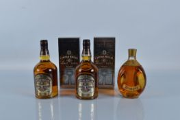 Two bottles of Chivas Regal 12 year old blended Scotch whiskey, together with a bottle of Dimple old