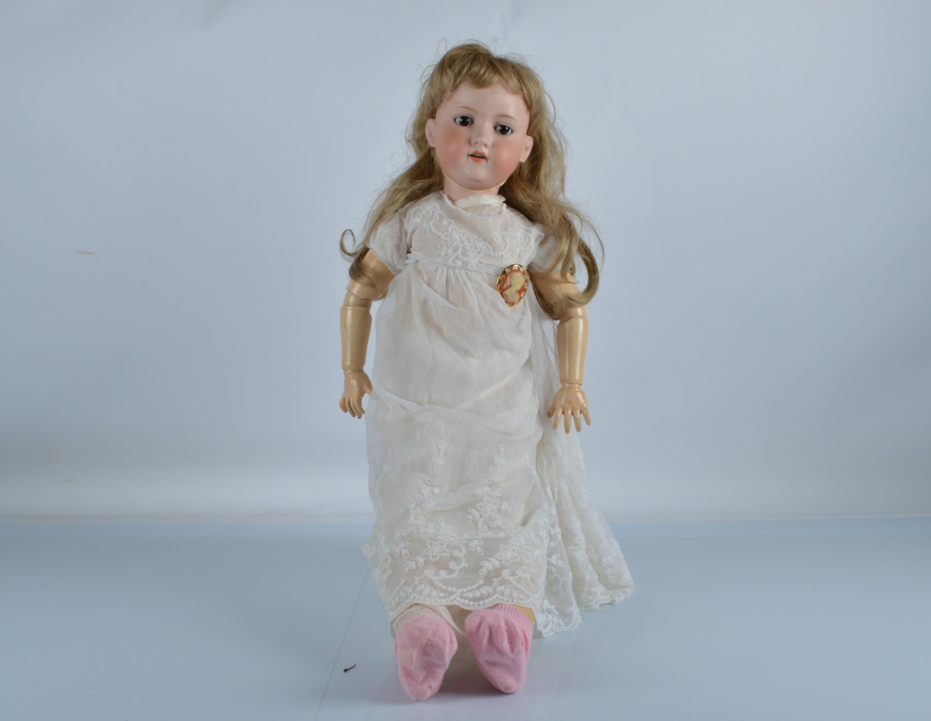 A large Armand Marseille 390n child doll, with brown sleeping eyes, replaced blonde wig, jointed