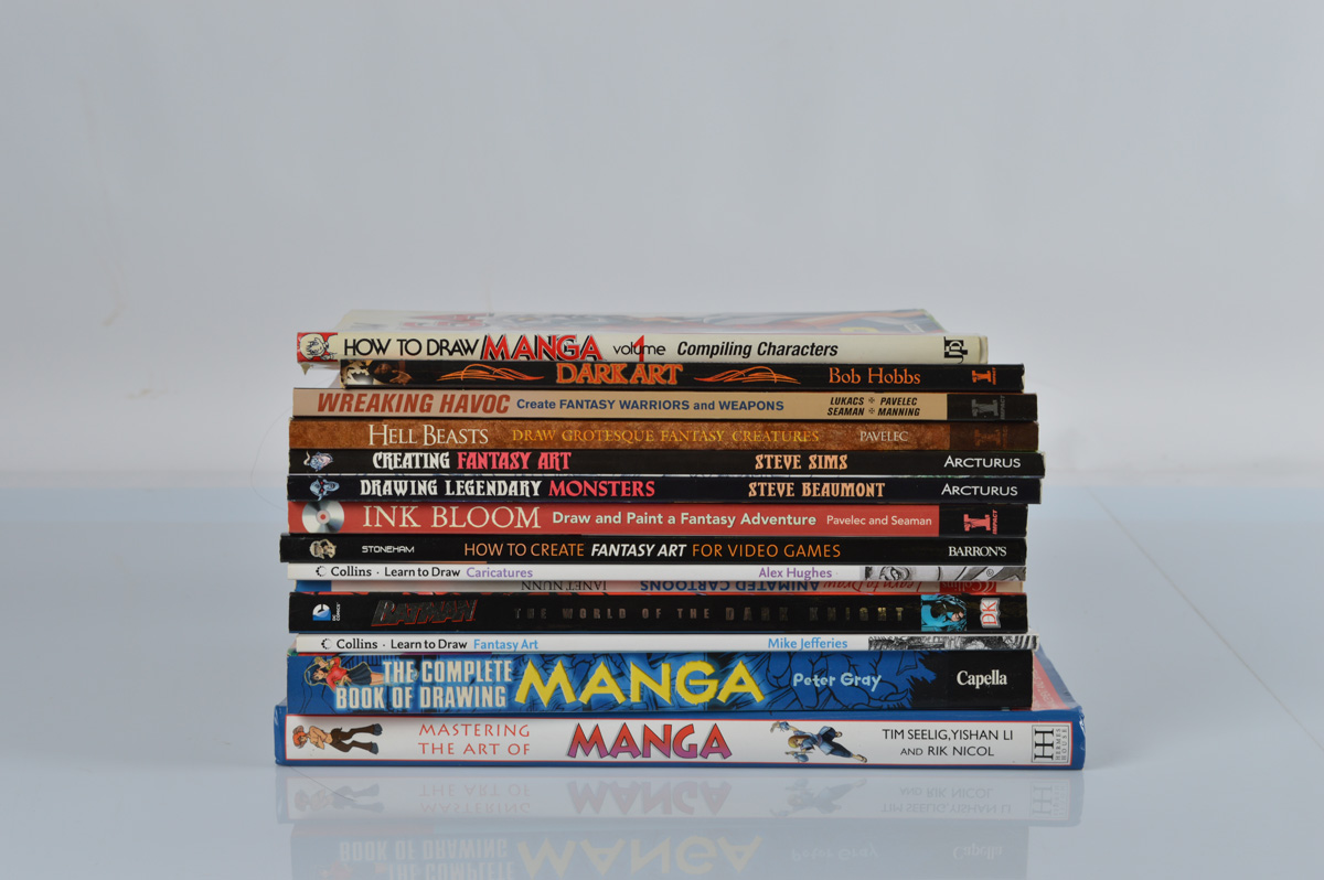 A collection of Fantasy themed drawing books, including Mastering The Art Of Manga, Hell Beasts,