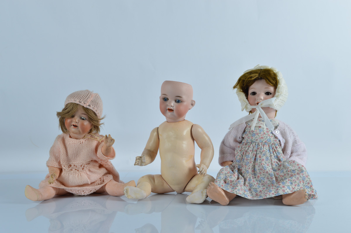 Three German bisque head baby dolls, with blue and brown weighted eyes, by Armand Marseille, two