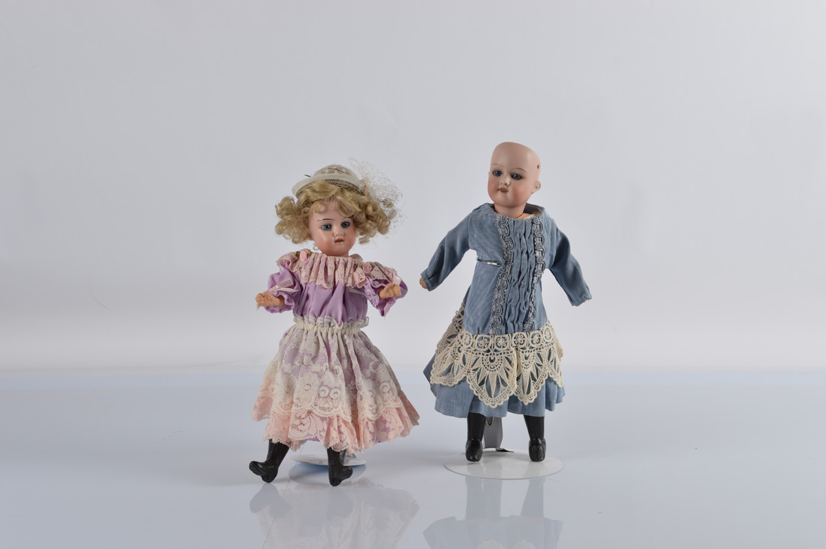 Two German bisque child dolls, both with fixed blue eyes, marked to back of head Made in Germany, on