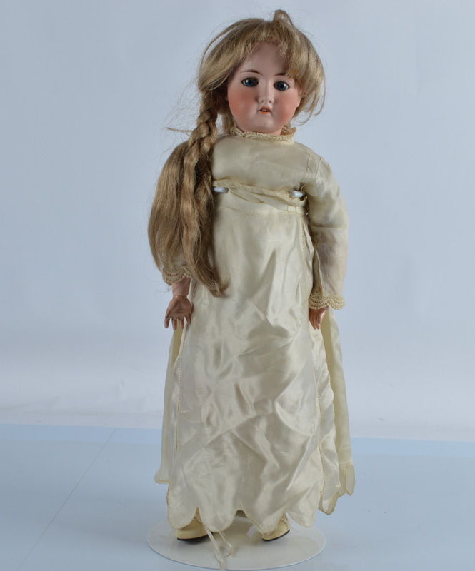 A German bisque head child doll, with weighted blue lashed eyes, open mouth revealing teeth on a