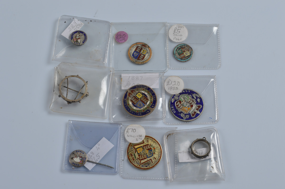Seven Georgian and Victorian enamel coins, including some with pin and brooch fittings and button