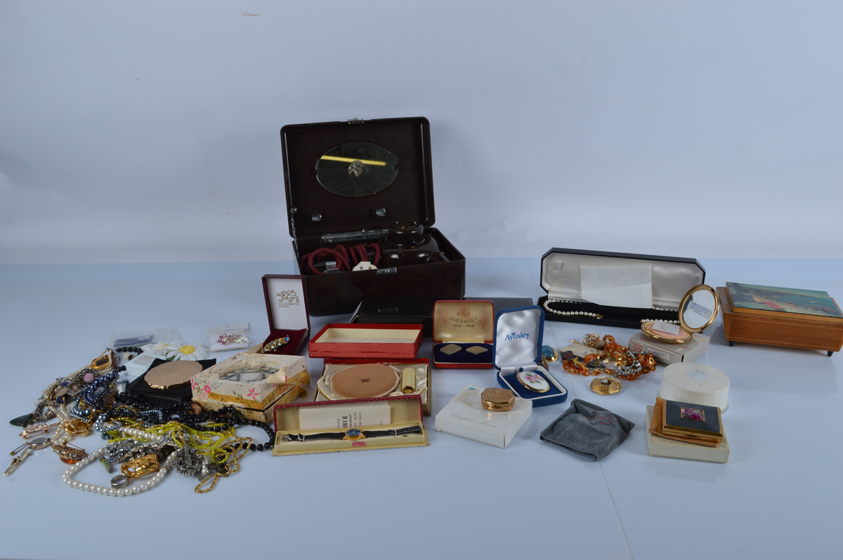 A good mixed lot of costume jewellery, together with various compacts including Stratton and a MOP