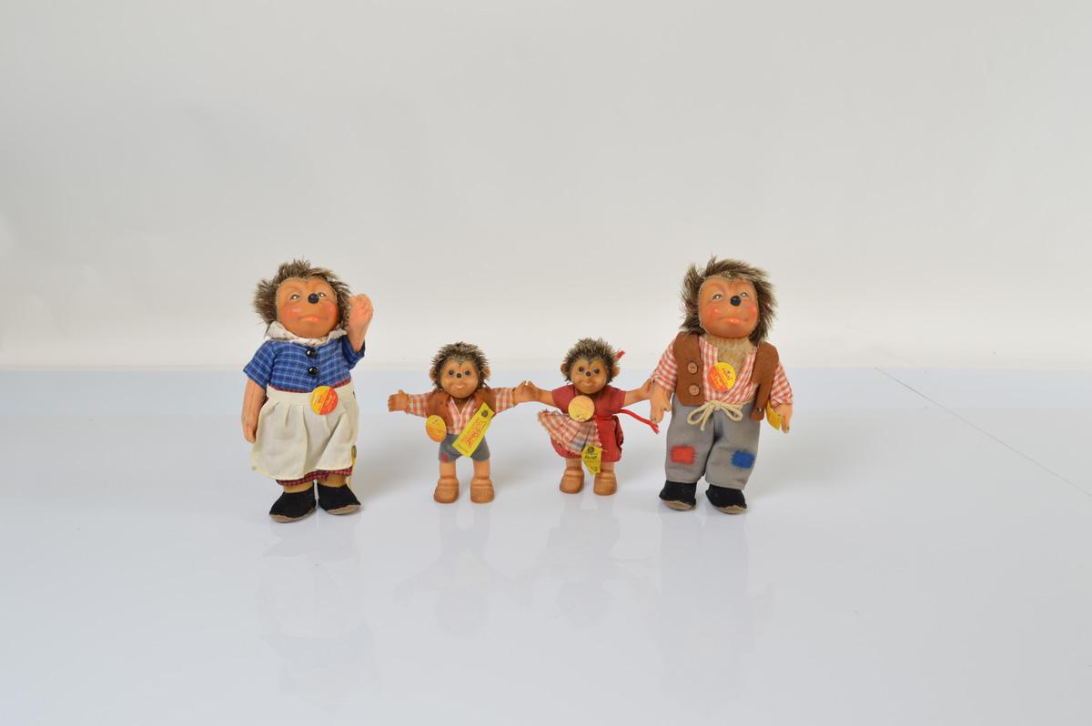 A family of four Steiff hedgehog figurines, comprising Mecki 18cm high, Micki 17cm high, Mucki 11.