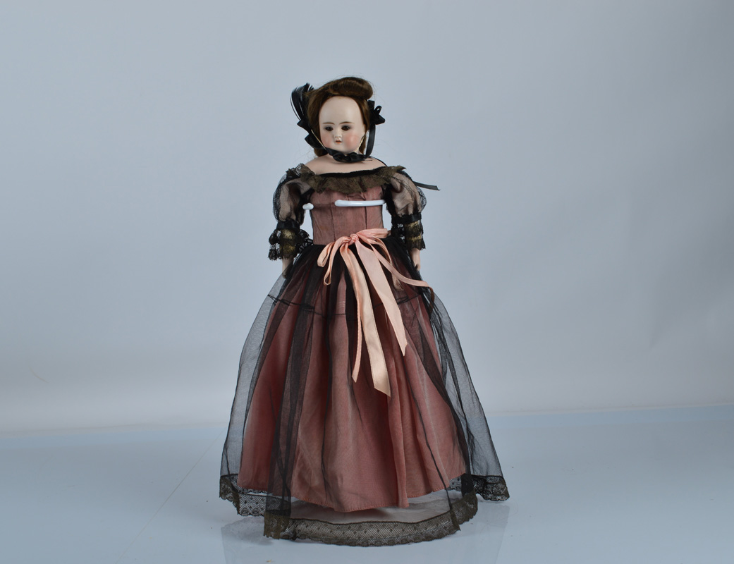 A German bisque shoulder head doll, with brown sleeping eyes, head turned slightly to the right