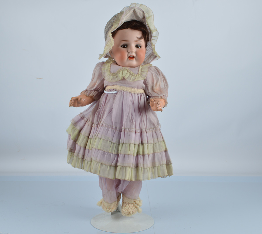 A Porzelanfabrik 169 baby doll, with brown sleeping eyes, replaced brown wig, composition toddler'