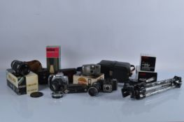 A good collection of assorted cameras, lenses and related equipment, including a Soligor tele-auto