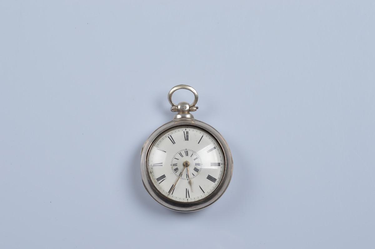 A Victorian silver pair cased pocket watch, by J. G. Jones, Pwllheli. Case hallmarked London, 1884.