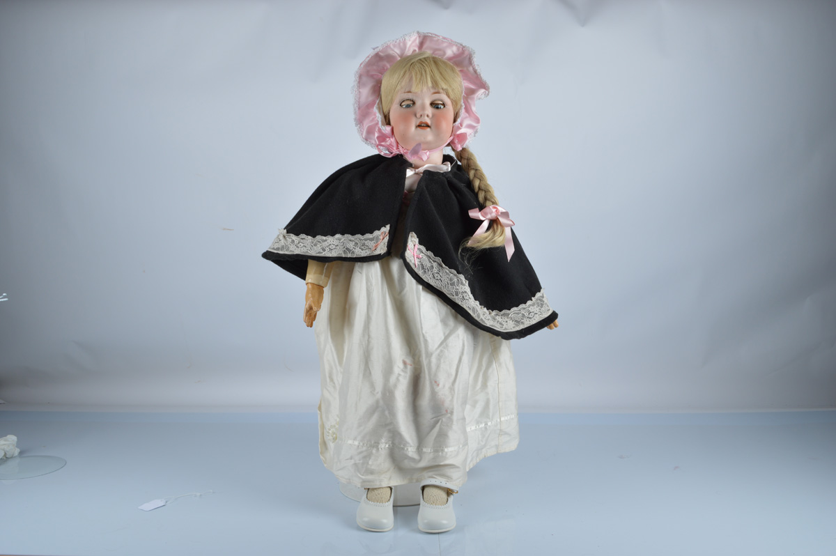 A large Armand Marseille 390 child doll, with blue sleeping eyes, replaced blonde wig, jointed