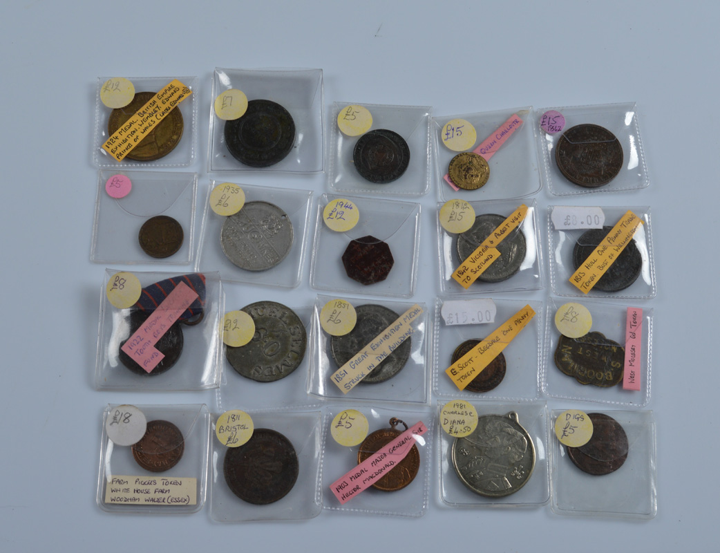 A collection of twenty 18th, 19th and 20th century tokens and medallions, including 1851 and 1924