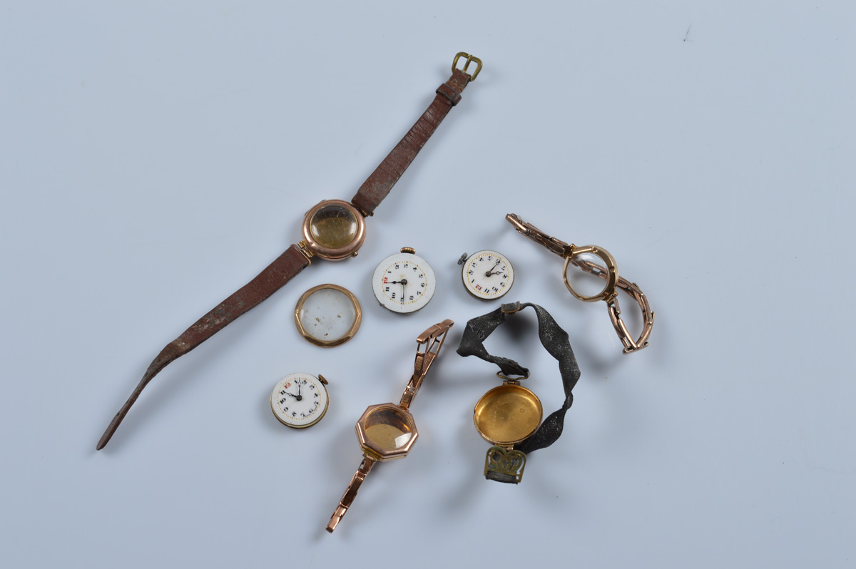 Three 9ct rose gold cased early 20th century wristwatches, together with one empty gold case on