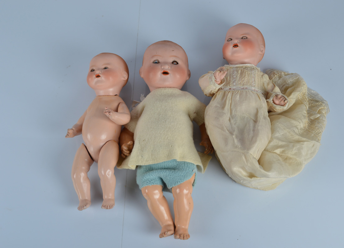 Three Armand Marseille 351 babies, all with blue sleeping eyes, blonde painted hair and bent
