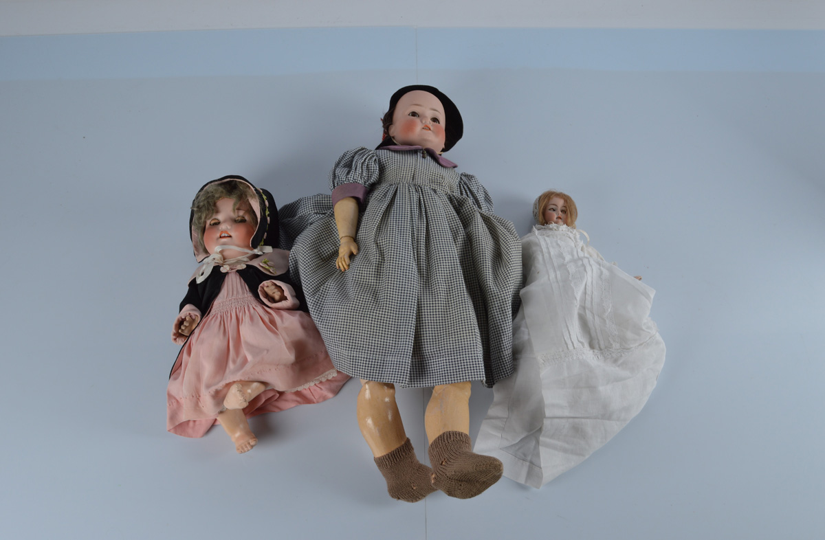 A Simon and Halbig child doll, with weighted brown eyes, open mouth, on a composite jointed body