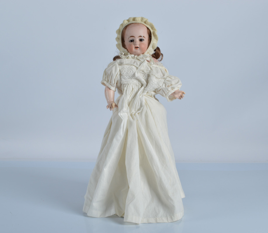 An early Ernst Heubach shoulder head doll, with head turned slightly to right, dark sleeping eyes,