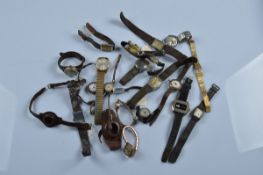 A mixed lot of mostly early 20th century wrist and trench watches, mostly leather strap examples
