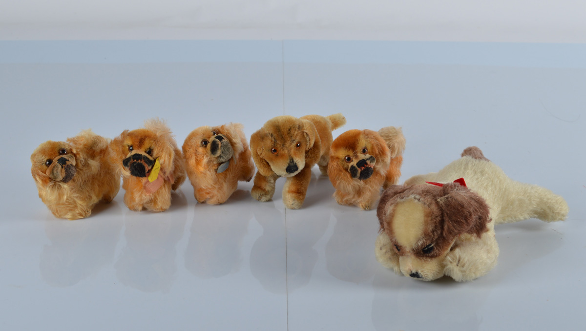 Post war Steiff dogs, four small Peky Pekinese, two with buttons and one with yellow cloth tag, 3