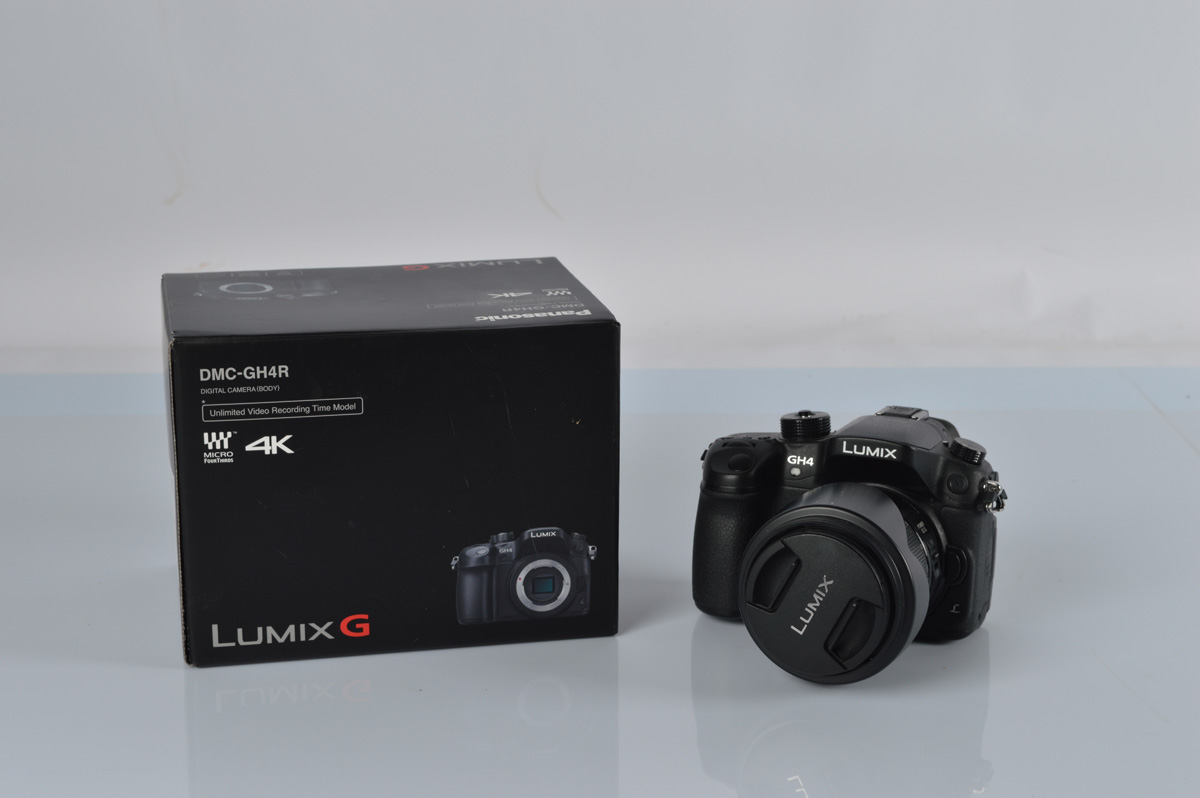 Panasonic Lumix DMC-GH4 4K digital camera, with a Lumix G Vario 1:3.5-5.6 /14-140 lens, with box.