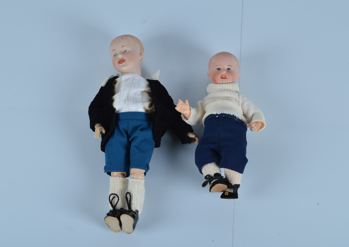 Two small German bisque headed character babies, the smaller with blue painted eyes, open/closed