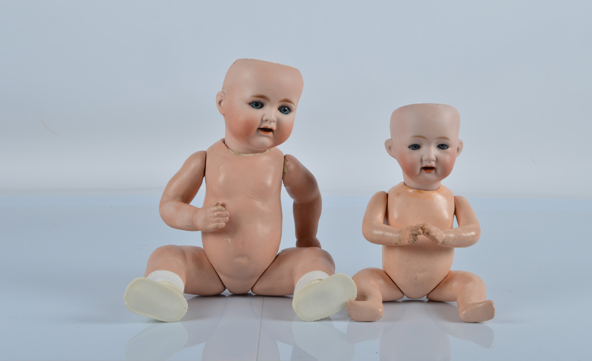 Two Japanese bisque headed babies, a Morimura Bros with blue sleeping eyes and bent limbed