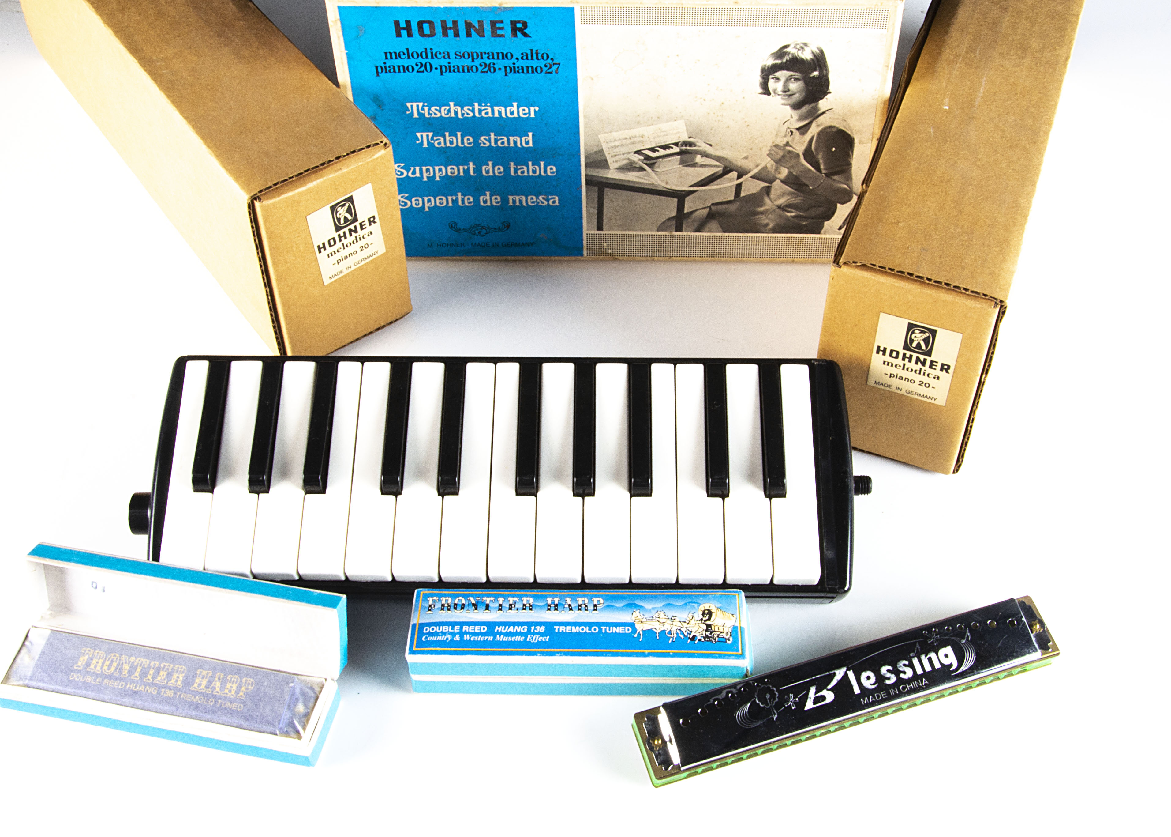 Hohner Melodicas / Harmonicas, three Hohner Melodicas, two Piano 20s, original boxes with cases (