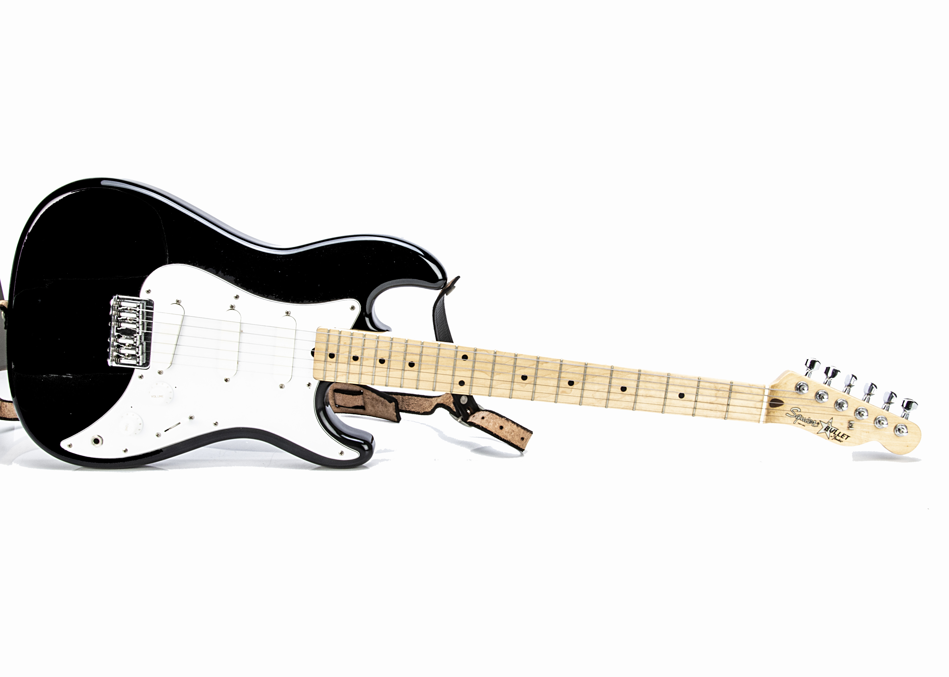 Squier Electric Guitar, a Squier 'Bullet' electric guitar by Fender, made in Japan, with strap, lead