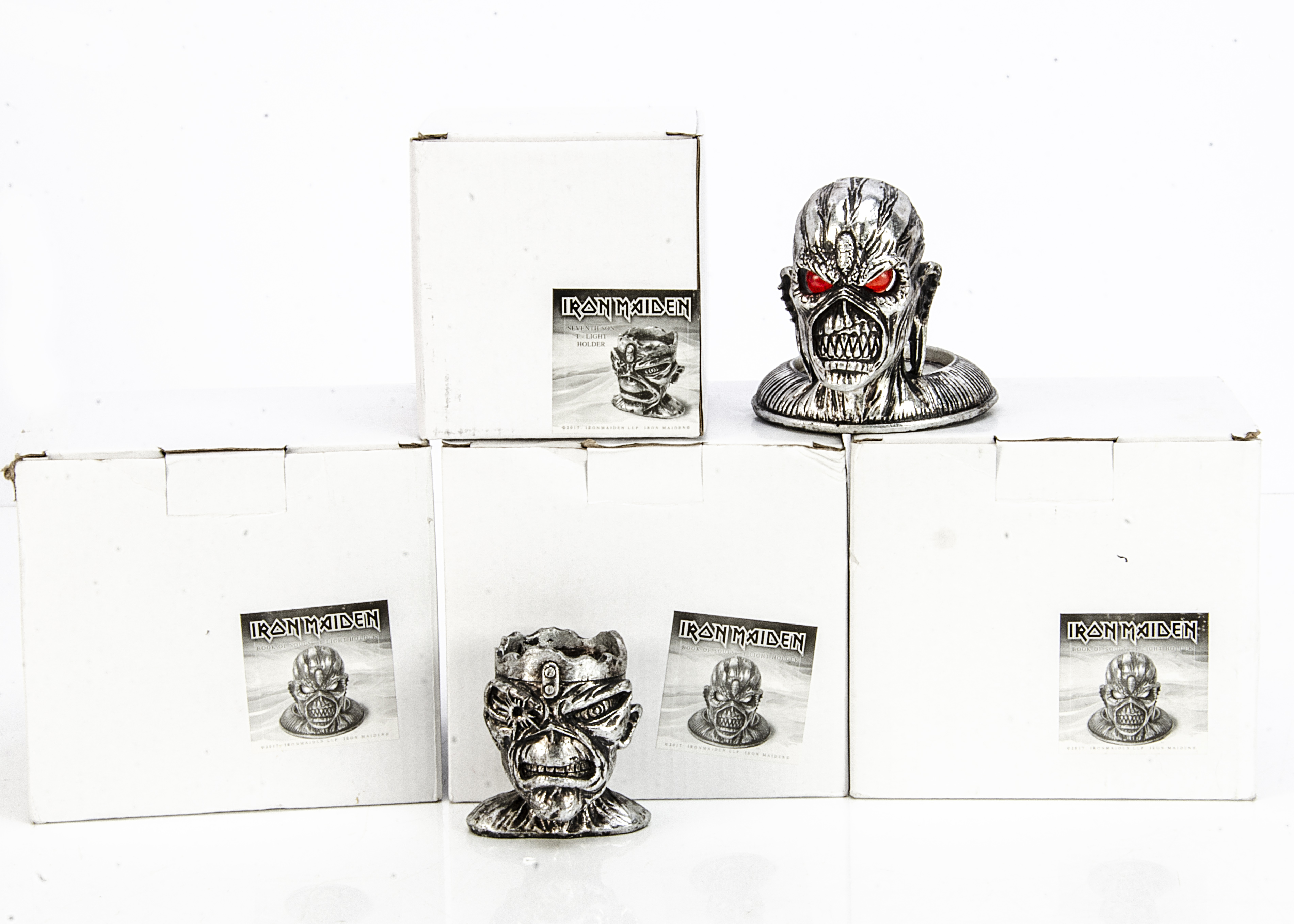 Iron Maiden T Light Holders, four Book of Souls T-Light Holders, all in stickered boxes and with