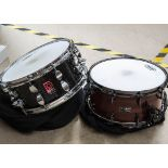 """Snare Drums, two snare drums, a 14"""" Premier Classic (black with silver) and a 14"""" A&M snare (dark"""