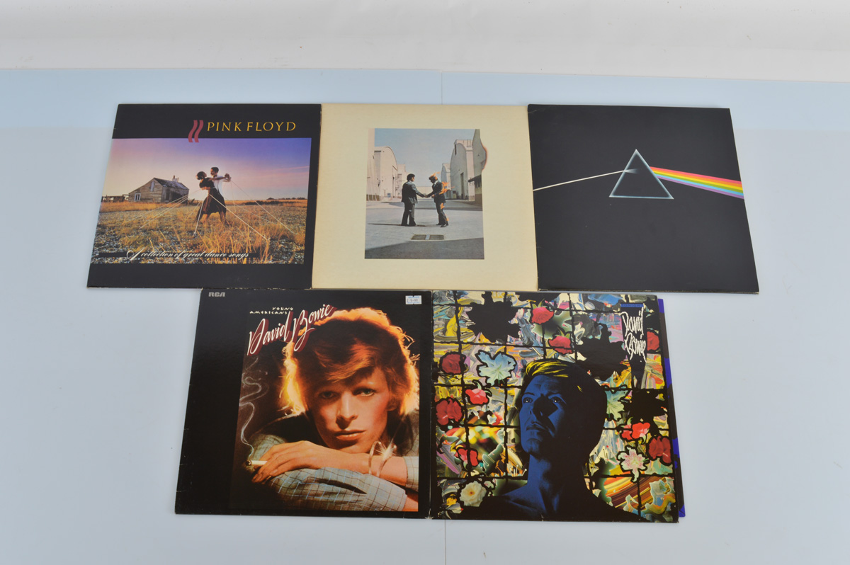 A large collection of vinyl records, including Phil Collins, Level 42, James Last, Fleetwood Mac,