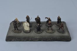 A set of ten Lord of the Rings metal figures with resin display stand, a quantity of mostly