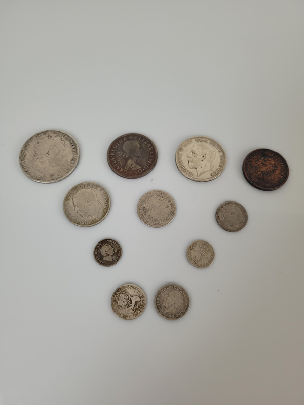 An 1820 George III silver crown, together with a collection of other Georgian and later coins,