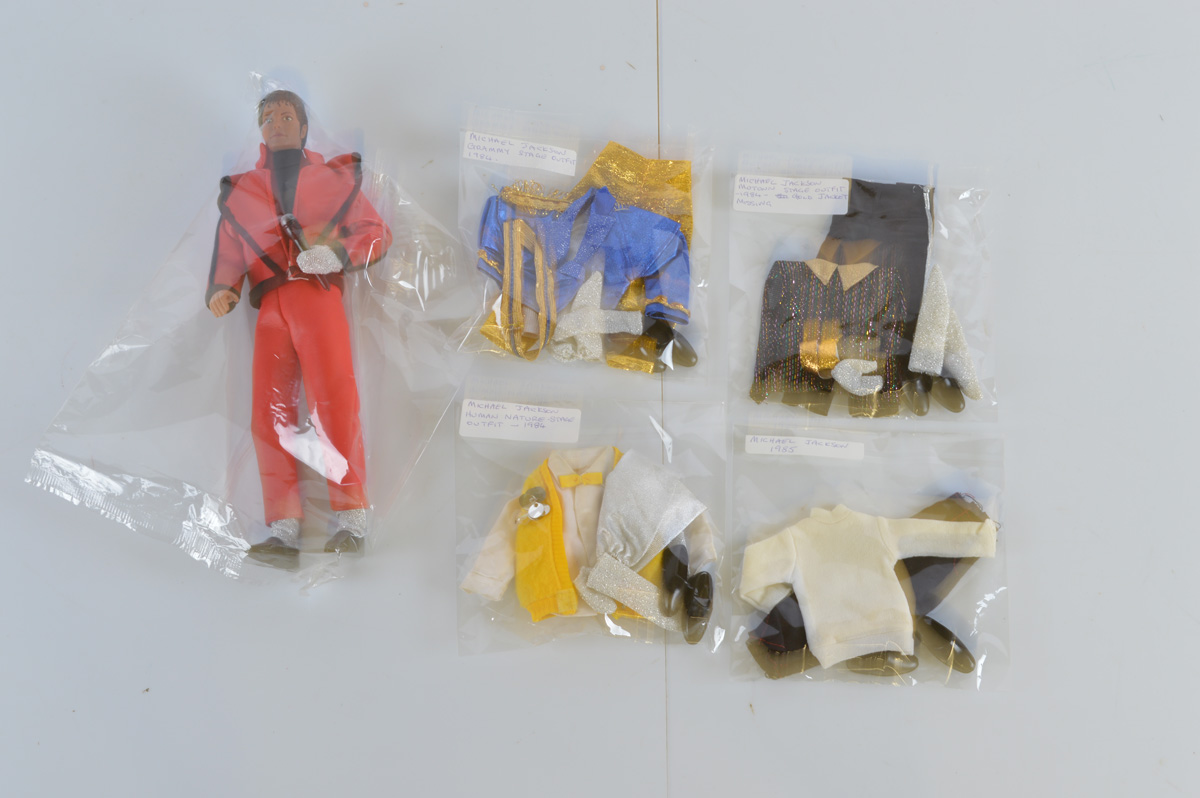 A Michael Jackson Thriller action figure, with various associated clothing